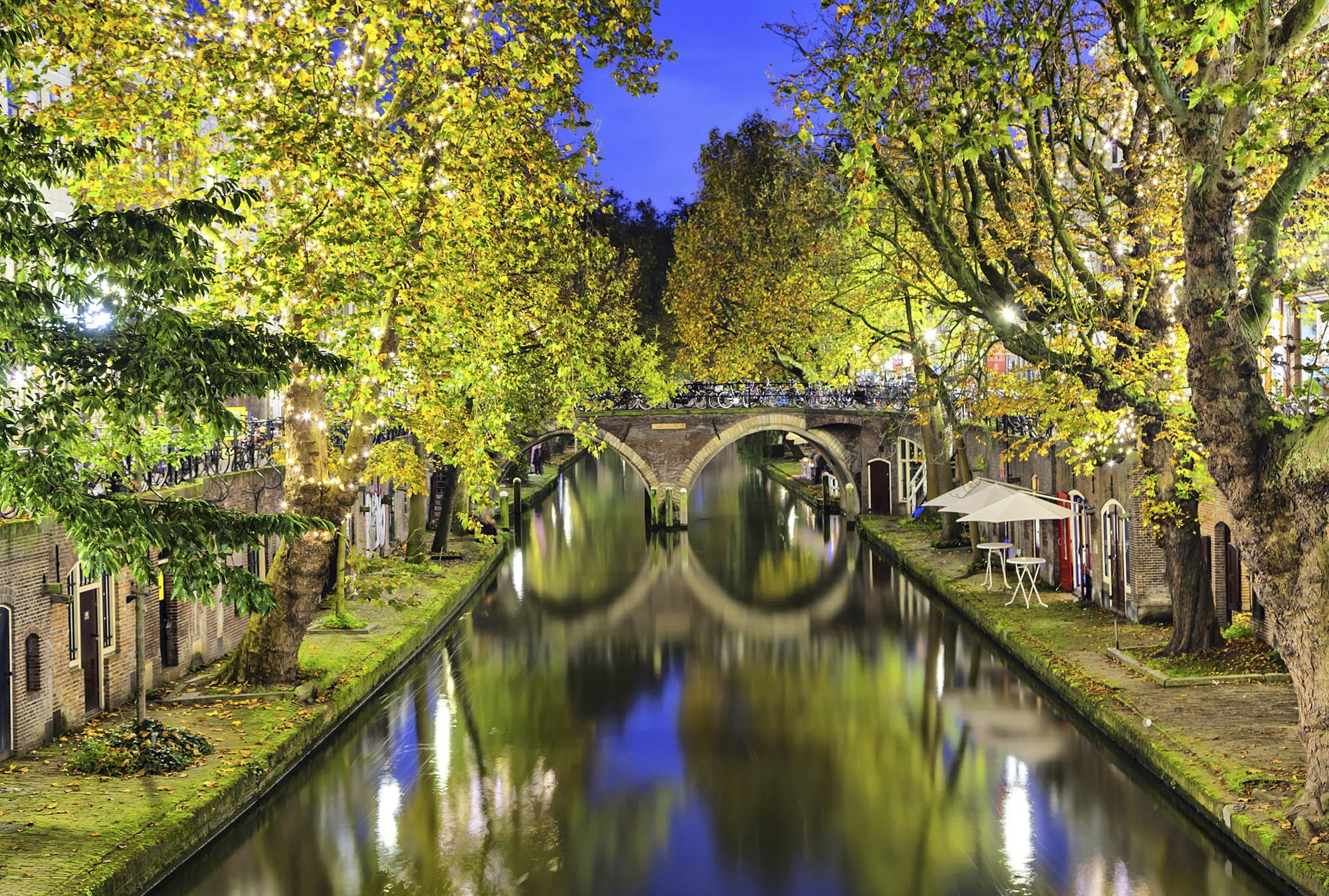 Double arc bridge across canal in the center of Utrecht in the evening, Netherlands
